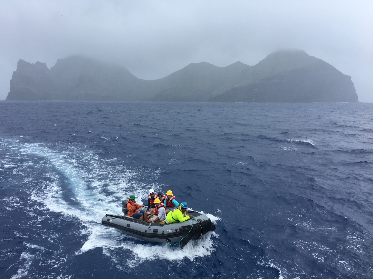 The small boat returns to NOAA Ship Oscar Elton Sette after a rainy but successful day on Nihoa surveying for Hawaiian monk seals