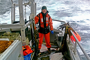 Bobbie Buzzell, fisheries observer, on board a boat.